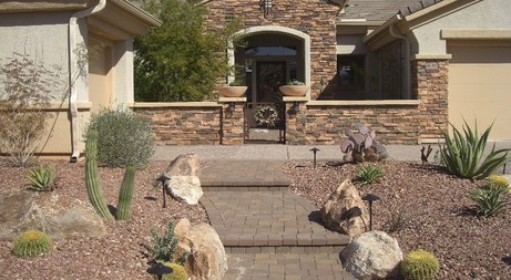 curb appeal with a stone courtyard entry