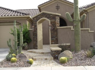 stone entry with stucco wall and desert landscape